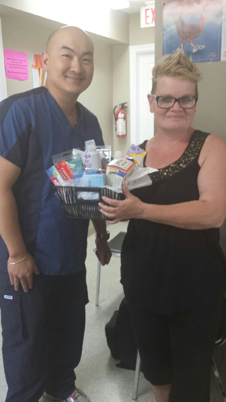 Foot Doctor Presenting Prize Pack To Patient