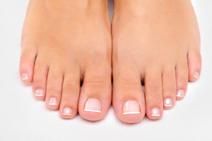 Beautiful-female-feet-with-French-pedicure-closeup