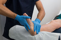 Doctor providing Foot Assessment