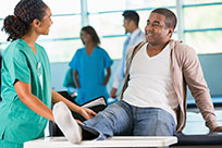 physical-therapist-helping-patient-with-injury-in-rehabilitation-hospital