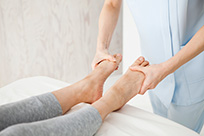 Doctor Massaging Woman's Feet