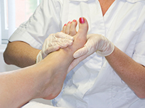 Podiatrist Checking For Onychomycosis