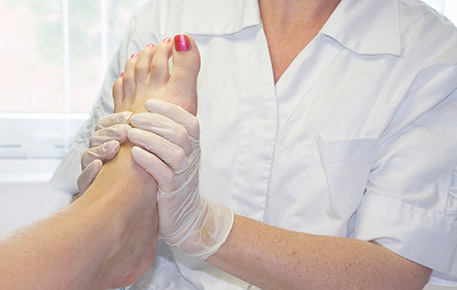 A Doctor Examining The Foot of a Patient